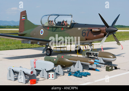Slovenian Air Force Pilatus PC-9M on display with selection of optional armament and opened cockpit canopy, Cerklje - Stock Image