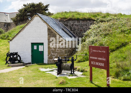 Heritage Centre Ice House and sign in village of Findhorn, Moray, Scotland, UK, Britain. The 19thc Icehouse stored ice for transporting salmon - Stock Image