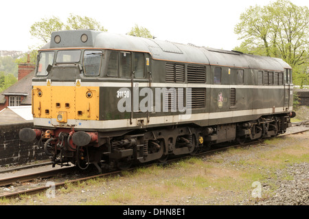 Privately owned lease hire Class 31 diesel locomotive in a 1960`s livery standing in a siding at Temple Meads station.brush type 2 - Stock Image