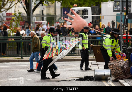 Brighton UK 4th May 2019 - Police help as thousands of schoolchildren , teachers and parents take part in the annual Brighton Festival Children's Parade through the city which has the theme 'Folk Tales from Around the World' . Organised by the Same Sky arts group the parade traditionally kicks off the 3 week arts festival with this years guest director being the singer songwriter Rokia Traore . Credit : Simon Dack / Alamy Live News - Stock Image