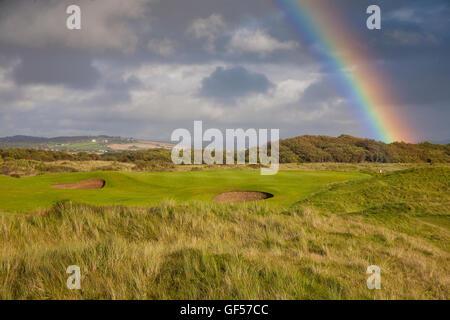 Saunton Golf Club East course Devon UK at sunset with rainbow - Stock Image