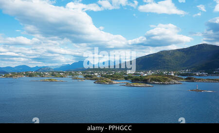 Horizontal shot with perspective from fjord, at high, vantage point, of the city of Bergen, unusual landscape with scattered villages, in Norway - Stock Image