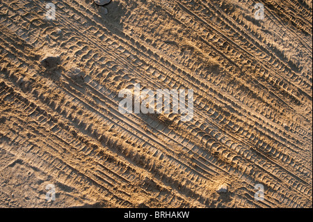 Tyre tracks in soft powdery soil - Stock Image