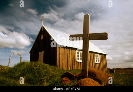 PICTURE CREDIT DOUG BLANE Cross small Church perched on the edge of a lava plain at Krysuvik Iceland - Stock Image