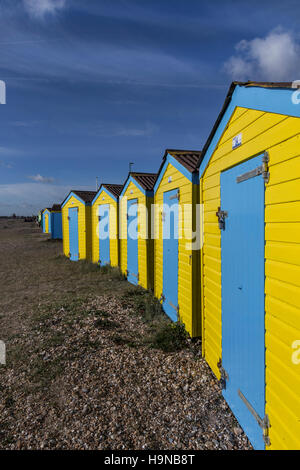 Blue and Yellow beach huts, Littlehampton, West Sussex, England - Stock Image