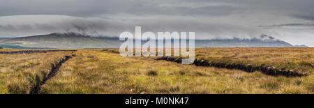 Panoramic view across cut bog near Ballycroy, County Mayo, Ireland, towards the Nephin Beg mountain range with a - Stock Image