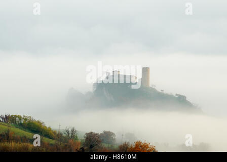 church with tower isolated in the fog - Stock Image