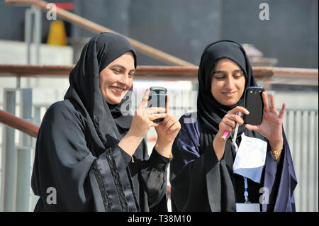 Dubai,United Arab Emirates-February 07, 2014:Young Dubai Women taking photographs with a Cell Phone - Stock Image