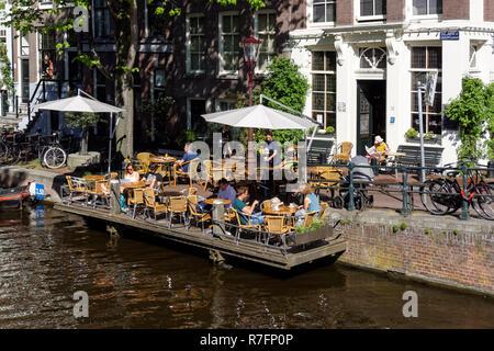 Restaurant on the Egelantiersgracht canal in Amsterdam, Netherlands - Stock Image
