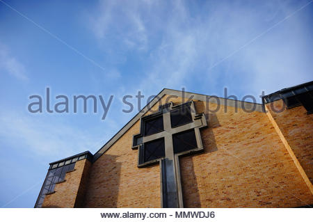 Top of a church with cross symbol on the Orla Bialego district in Poznan, Poland - Stock Image