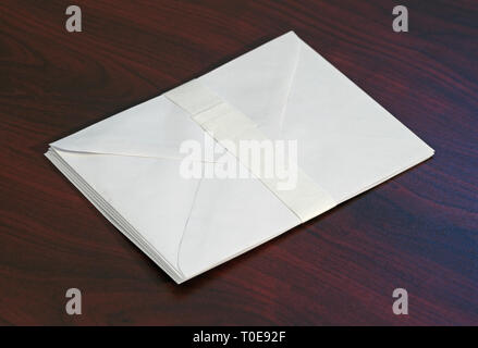 stack of white envelopes - Stock Image