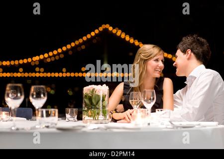 Couple dining outdoors, Brisbane QLD Australia - Stock Image
