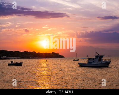 Wonderful sunset in Thasos island, Greece as seen from the shore at Prinos town - Stock Image