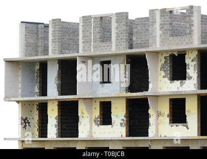 Old aged weathered grunge unfinished demolished multi-storey residential apartment flat unit panel condo building, large detailed urban grungy loggia - Stock Image