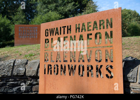 Sign outside the historic Blaenavon Ironworks museum, part of the Blaenavon UNESCO World Heritage Site in Wales, UK - Stock Image