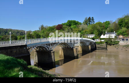 Chepstow bridge which crosses River Wye between Monmouthshire Wales and Gloucester England so can stand with a foot in each country - Stock Image