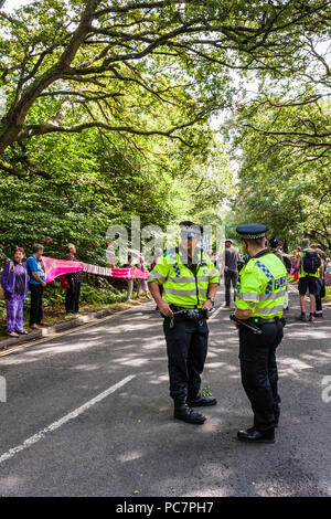 Police on duty at a peaceful protest by members and supporters of the Campaign for Nuclear Disarmament (CND) near AWE, Aldermaston. - Stock Image