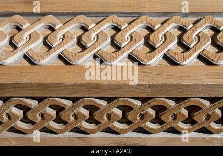 brown decorated wood panel outdoor closeup - Stock Image