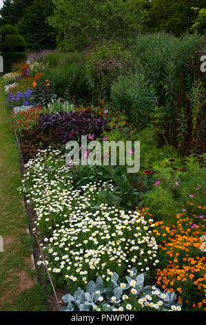 Summer Garden Borders In Full Bloom with Flowers in The UK - Stock Image