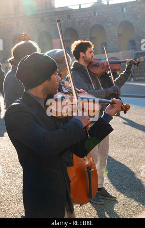Italy Florence Tuscany four men play in a quartet in Florence buskars for money outdoors - Stock Image