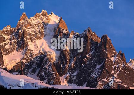 Sunset on the Chamonix Needles (Aiguille du Plan and Dent du Crocodile summit). Mont Blanc mountain range, Chamonix, Upper Savoy (Haute-Savoie), Alps, - Stock Image