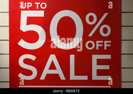 up to 50% sale off sign in a clothing store in the UK - Stock Image