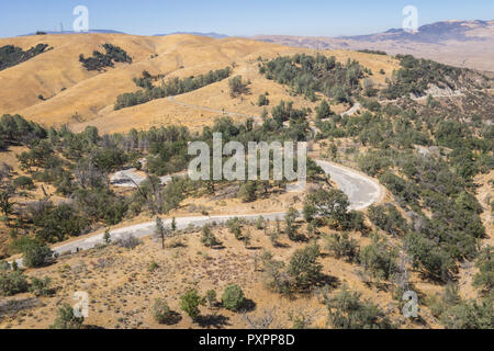 Winding road leads through the hills of southern California's wooded wilderness. - Stock Image