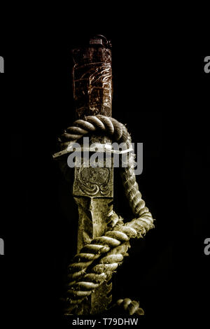 Hunting knife isolated on black background. The focus is on the blade of the knife - Stock Image
