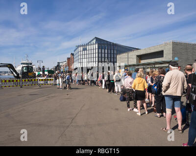 The passenger ferries on the Norwegian Oslo fjord are popular when the weather is warm and sunny, crowds waiting in line for a day cruise to Drøbak - Stock Image