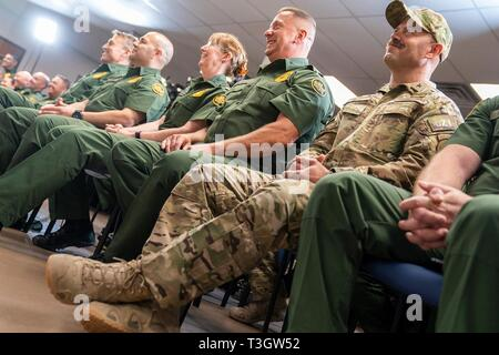 CBP Agents listen during a border security roundtable with U.S President Donald Trump at the Border Patrol Calexico Station April 5, 2019 in Calexico, California. Trump visited the section of wall at Calexico that was part of a replacement project started under President Obama. - Stock Image