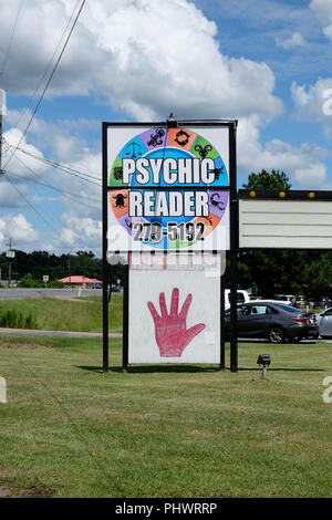Psychic reader outdoor exterior roadside sign advertising palm reading in Wetumpka Alabama, USA. - Stock Image
