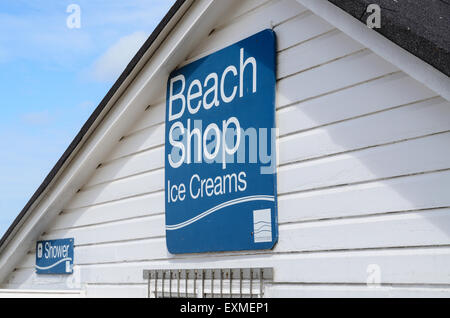 Sign for the Beach Shop at Porthminster Beach, St Ives, Cornwall, U.K which sells Ice Creams, Toys and Beach Essentials. - Stock Image