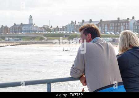 Southwold, UK - September 10, 2018 - Two tourists looking over the beautiful view of Southwold from the pier - Stock Image