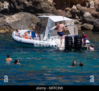 People enjoy seaside activities on a warm summer`s day in Cala Deia beach, Mallorca, Spain. - Stock Image