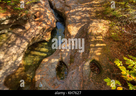Pole aerial High Dynamic Range (HDR) image of a rapids among rock formations carved over time at Waterford, Kings - Stock Image