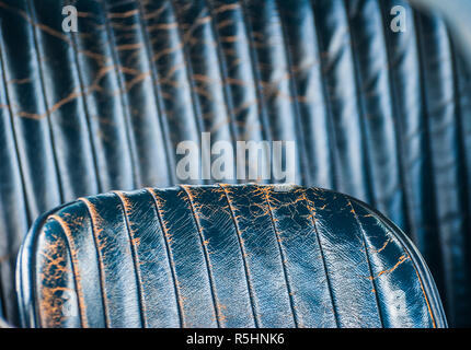 Old leather vintage car seat detail. - Stock Image