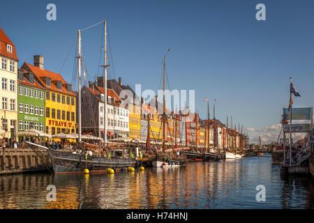 Copenhagen Nyhavn Canal - The famous colourful houses line - Stock Image
