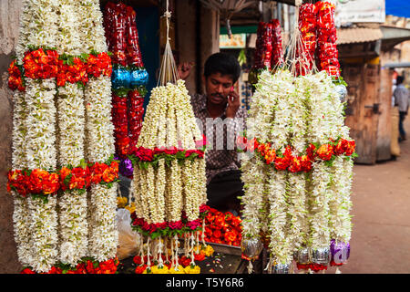 MYSORE, INDIA - MARCH 26, 2012: Flower offerings at the local market in India - Stock Image