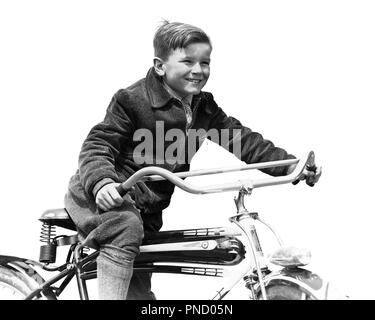1930s SMILING BOY IN AUTUMN CORDUROY JACKET KNEE SOCKS AND PANTS  PEDALING HEAVY AMERICAN SPACE SHIP DESIGN STYLE BICYCLE  - b394 HAR001 HARS LIFESTYLE SPEED SATISFACTION BIKING RURAL HEALTHINESS COPY SPACE HALF-LENGTH PHYSICAL FITNESS HEAVY MALES RISK BICYCLES TRANSPORTATION EXPRESSIONS B&W BIKES FREEDOM SUCCESS DREAMS HAPPINESS CHEERFUL HEADLIGHT ADVENTURE DISCOVERY STRENGTH AND CORDUROY EXCITEMENT RECREATION PRIDE SMILES KNEE SOCKS IMAGINATION JOYFUL PEDDLING STYLISH JUVENILES PEDALING PRE-TEEN PRE-TEEN BOY BLACK AND WHITE CAUCASIAN ETHNICITY HAR001 OLD FASHIONED - Stock Image