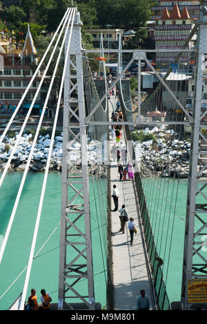Laxman Jhula iron suspension bridge spanning the holy Ganges in Rishikesh, northern India - Stock Image