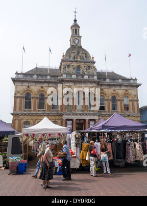 Ipswich Cornhill Market stalls in front of the Town Hall building, Suffolk England UK. - Stock Image