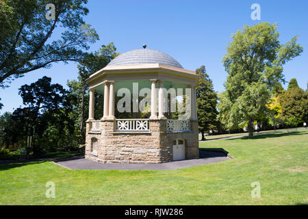 A bandstand surrounded by manicured lawns adorns St. David's Park in Hobart, Tasmania - Stock Image
