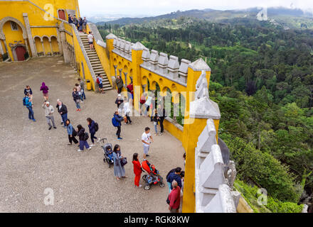 Tourists at the Arches Yard in the Pena National Palace in Sintra, Portugal - Stock Image