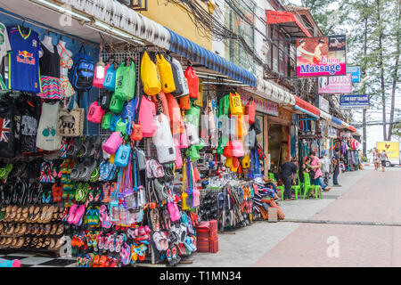 Patong Beach, Thailand - 6th January 2017: Souvenir shops and massage parlours. Phuket is a renowned holiday destination. - Stock Image