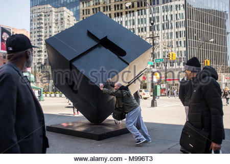 New York, NY, USA 24 March, 2018 - A man spins the Alamo in Astor Place. ©Stacy Walsh Rosenstock - Stock Image