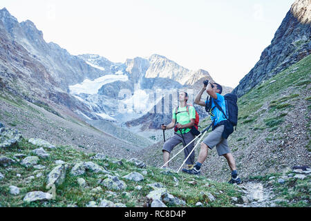 Hikers using binoculars, Mont Cervin, Matterhorn, Valais, Switzerland - Stock Image