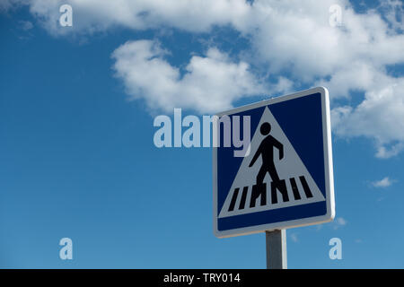 Road crossong sign against a blue sky background - Stock Image
