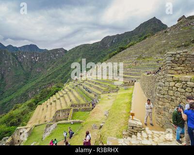 Machu Picchu, Peru - January 5, 2017. View of the tourists visiting the Machu Picchu citadel - Stock Image