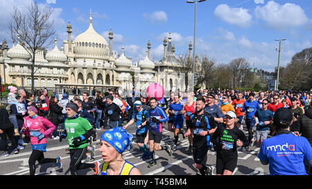 Brighton, Sussex, UK. 14th Apr, 2019. Thousands of runners pass by the Royal Pavilion as they take part in this years Brighton Marathon which is celebrating its 10th anniversary Credit: Simon Dack/Alamy Live News - Stock Image