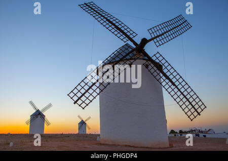 Traditional windmills at rising, Campo de Criptana, La Mancha, Spain - Stock Image
